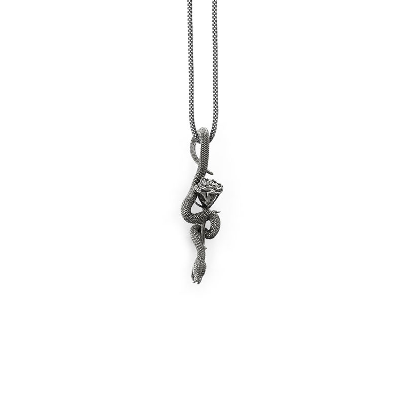 Snake pendant with rose in silver by Feel No Pain jewelry