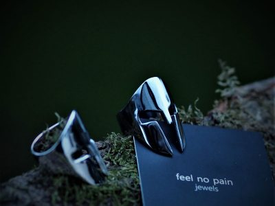 Spartan Ring in Silver and Black Rhodium on a wooden base and green moss - Feel No Pain