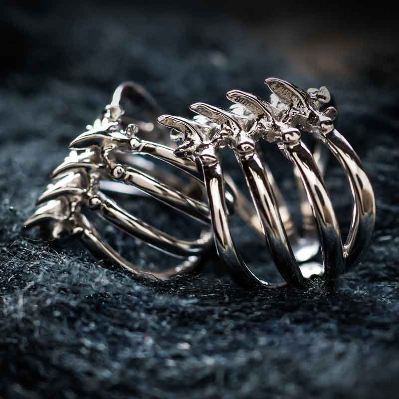 Rib Cage Ring in Sterling Silver on metallic straw