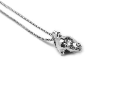 Anatomical Heart Pendant in Sterling Silver on a white background - Side View