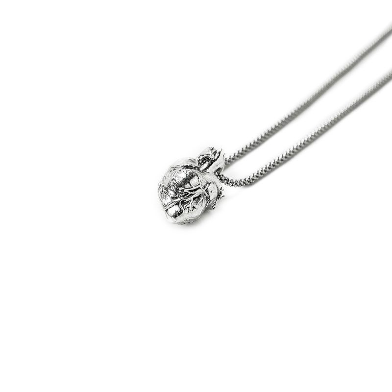 Anatomical Heart Pendant in Sterling Silver on a white background - Side View 2