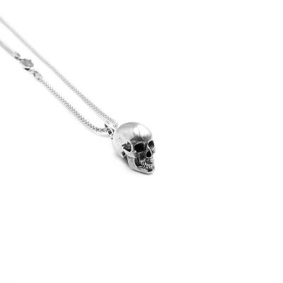 Anatomic Skull Pendant in Sterling Silver on a white background - Side View