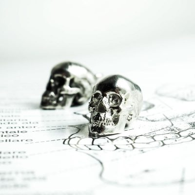 Anatomy Skull Pendant in Sterling Silver on Anatomy Book - Front View
