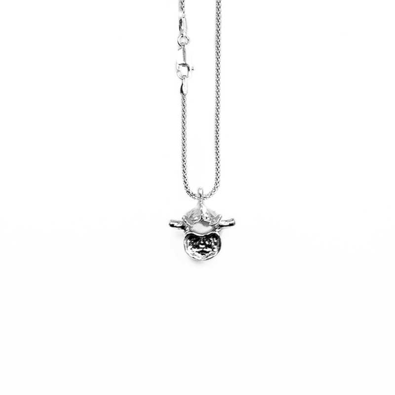 Lumbar Vertebra Pendant in Sterling Silver on a white background - Front View