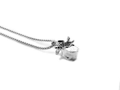 Lumbar Vertebra Pendant in Sterling Silver on a white background - Side View