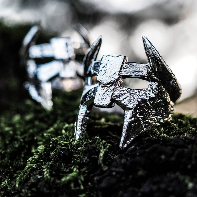 Viking Helm Ring in Silver 925 on wood trunk and green moss.