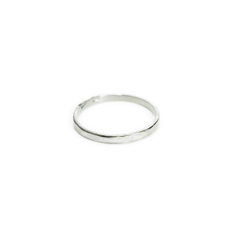 Hephaestus Small ring with hammering on white background - Side view