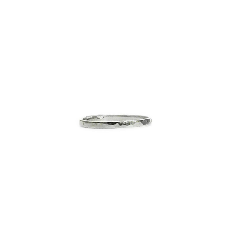 Hephaestus Small ring with hammering on white background - front view