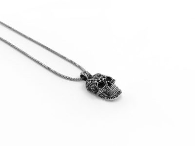 Xeno Skull Pendant in Sterling Silver on a white background - Side View