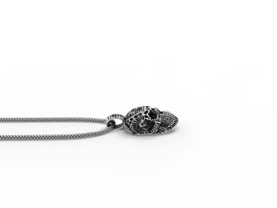 Xeno Skull Pendant in Sterling Silver on a white background - Side View 2