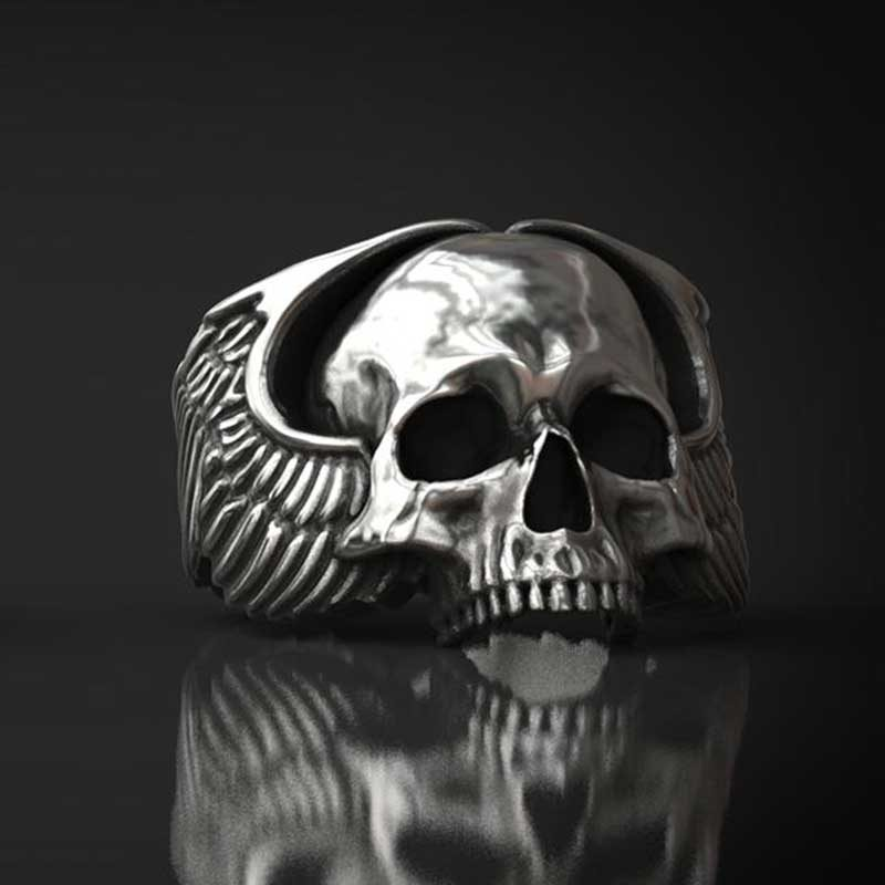 Anello teschio con ali d'angelo in argento realizzato con render