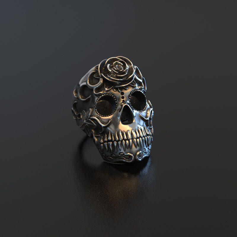 Anello con teschio messicano los muertos in argento con uno sfondo colore antracite