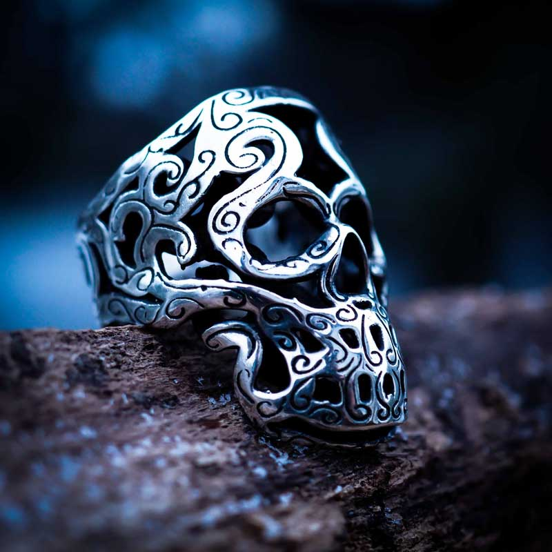 Maori Skull Ring in Sterling Silver with wood background - Feel No Pain